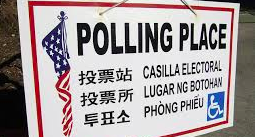 Sign in multiple languages that reads Polling Place